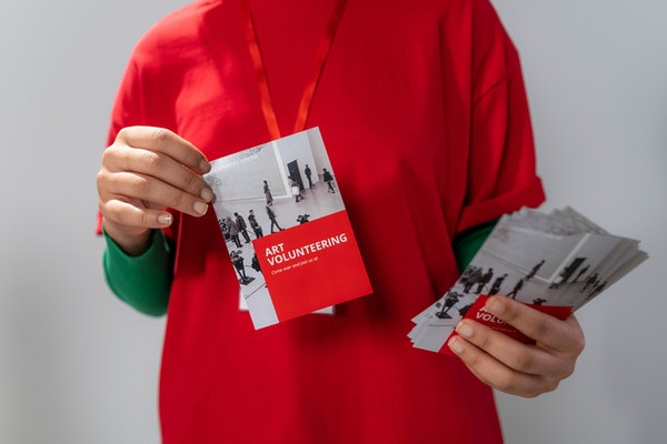 Bwoman holding booklet