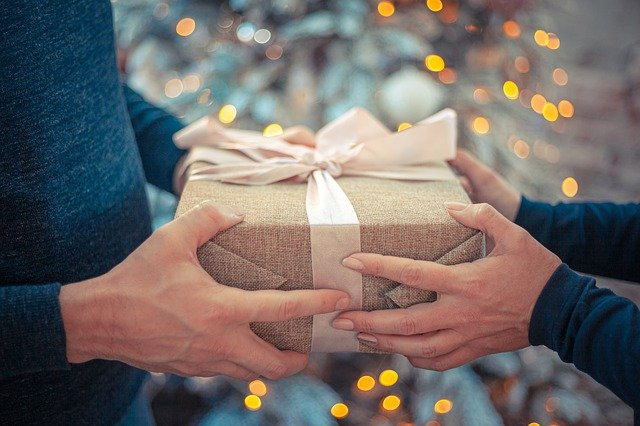 a girl giving gift to him