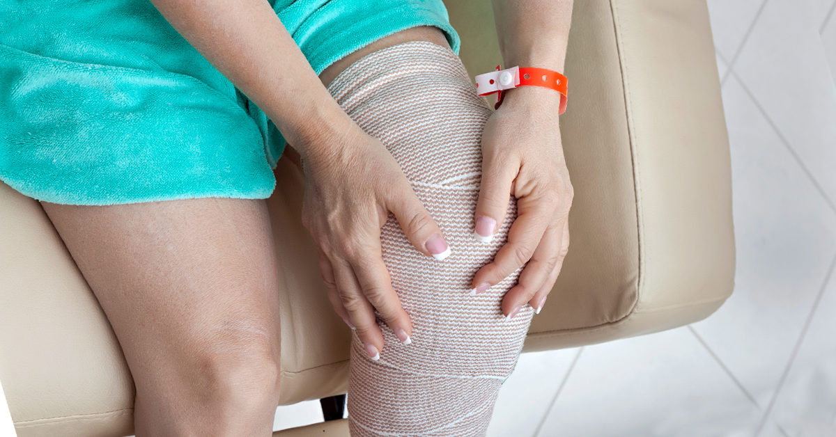 lady holding her knee after total knee relacement